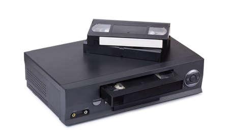 videocassette: grabadora de vídeo VHS de edad con casetes aislado en el fondo blanco Foto de archivo