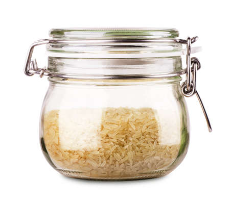 Raw rice in a jar isolated on white background
