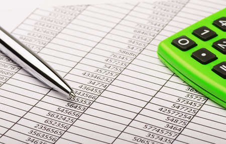 report: Calculator and pen on financial report Stock Photo