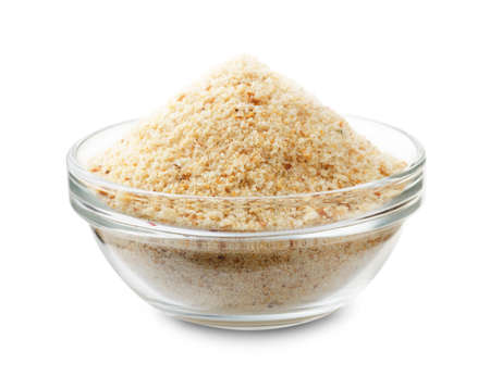 Bread crumbs in a glass bowl isolated on a white background