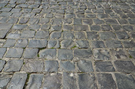 bumpy: Rough tiles stone pavement, background