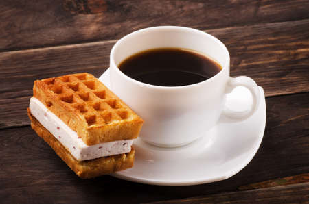 Coffe and viennese waffles on a wooden table