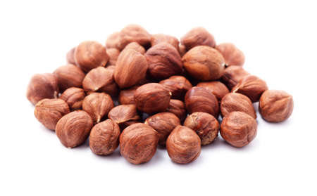 Heap of purified hazelnuts isolated on a white background Stock Photo