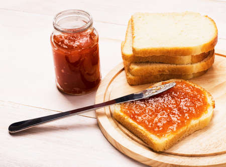 anointed: Fresh toasts with homemade apricot jam on cutting board