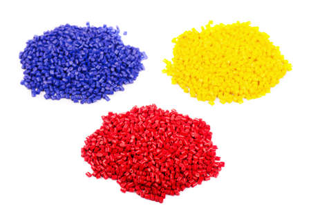 Colorful plastic polymer granules isolated on white background  Stock Photo