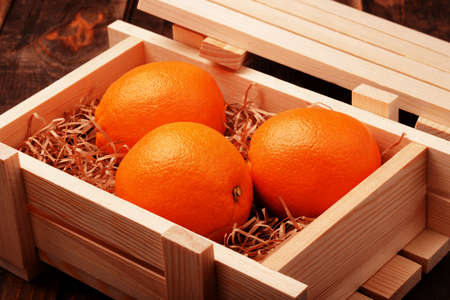 Oranges in a wooden box