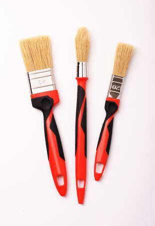 Set of three paint brushes for repairs