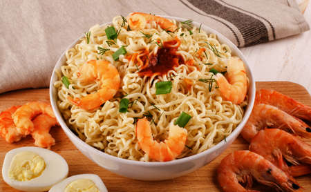 Rice noodles with shrimps close-up on the table top view of a horizontal Stock Photo
