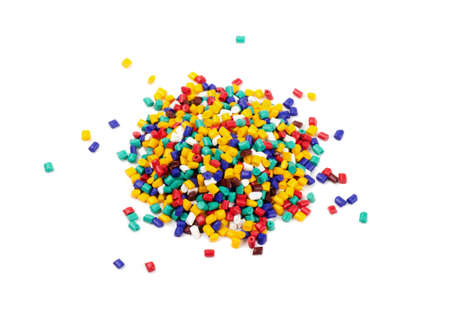 Colourful plastic granules on a white background Stock Photo