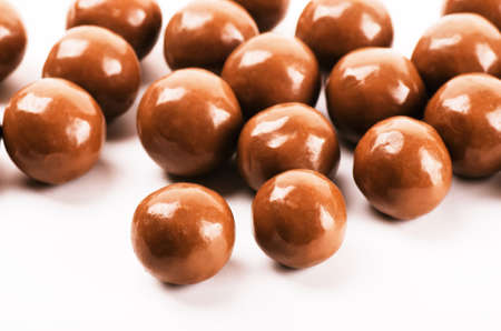 Chocolate balls on a white background close-up
