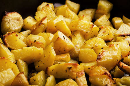 Roasted potato in utensils for cooking Stock Photo