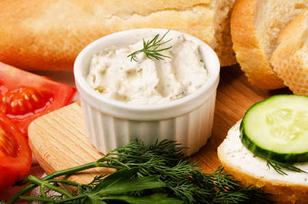 Cottage cheese with vegetables and bread cutting board