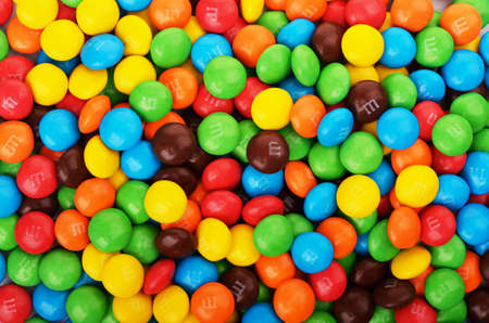 SAMARA, Russian Federation - April 29, 2017: M&Ms candies. M&Ms produced by Mars, Incorporated. Close up of a pile of colorful chocolate coated candy, chocolate pattern, candies background Editorial