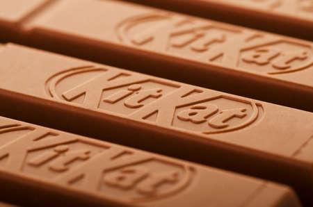 SAMARA, RUSSIA - January 6, 2018: Kit Kat broken chocolate bar. Kit Kat is a chocolate biscuit bar with logo as background
