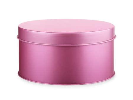 Caja redonda de metal violeta, rosa sobre un fondo blanco. Foto de archivo