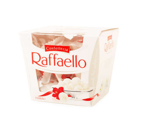 KRASNODAR, RUSSIA - February 4, 2019: Square box of sweets Rafaello - Crispy coconut with whole almond. Produced by the Italian company Ferrero. Valentine's Day treat. Editöryel