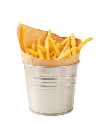 French fries in metal bucket isolated on a white background