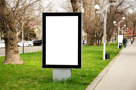 City format blank vertical street billboard stand mock-up with city background