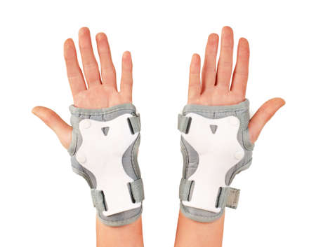 Roller skater wearing wards guards protector pads, wrist protection on hands woman isolated white background