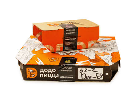 MOSCOW, RUSSIA - JUNE 21, 2019: Dodo pizza and fondant in paking. Russian Fast food in cardboard packaging