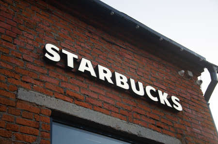 Moscow, Russia - 28 July, 2018: Starbucks coffee shop famous branches in Moscow.  Logo Starbucks sign on a brick wall close-up.