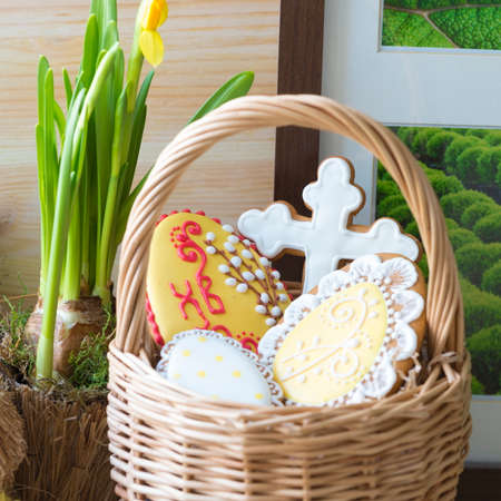 Easter gingerbread cookie bunnies with bucket of speckled Easter eggs