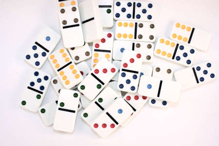 Dominoes in color in a loose pile Stock Photo
