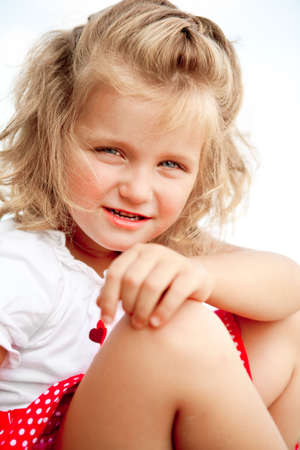 little blonde girl  looking to the camera with curiosity Stock Photo