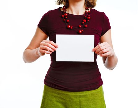 woman with empty sheet of paper in hands, on plain white background Stock Photo