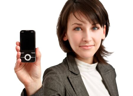 brunette woman holding a cellphone - sharpness on the cellphone Stock Photo - 6601494