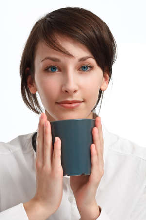 beautiful young woman with mug in hands looking straight to viewer, on white background Stock Photo - 6601447