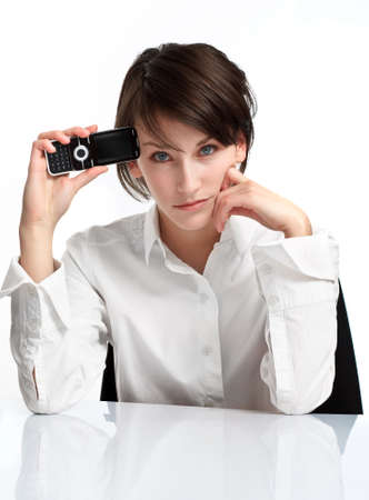 young brunette with cellphone, upset and sad. on white background Stock Photo - 6601489