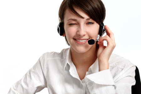 winking woman operator with headset - microphone and headphones, on white Stock Photo - 6601488