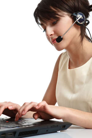 woman operator with headset (microphone and headphones) working - using a notebook Stock Photo - 6601459