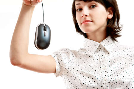 computer mouse hunted by young woman - sharpness on the mouse Stock Photo