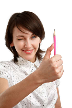 young woman virtually measuring with a pencil - sharpness on pencil
