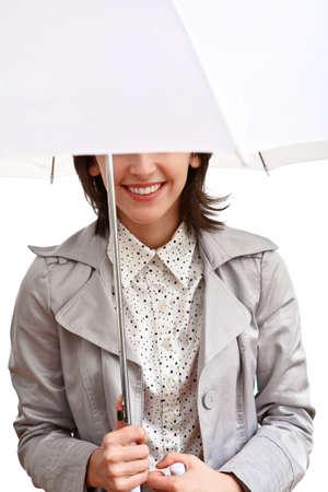 smilling girl in grey coat under white umbrella  Stock Photo