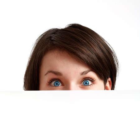 partially hidden face with big blue eyes