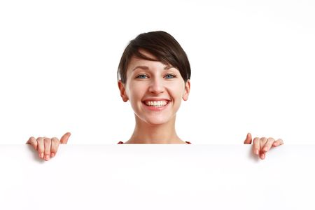 beautiful girl holding an empty white board ready to be filled with some text Stock Photo - 6601446