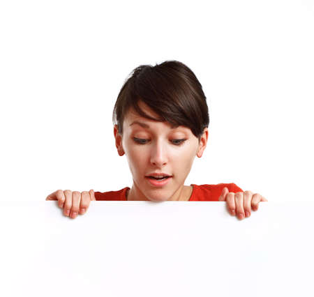 beautiful girl holding an empty white board ready to be filled with some text, on white background Stock Photo - 6601445