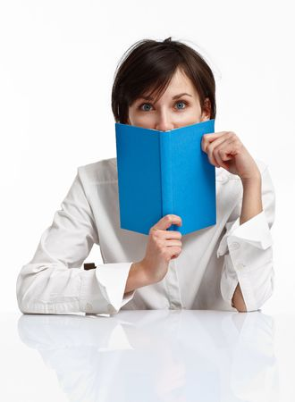 young woman with big blue eyes holding a book, looking to the viewer on white background