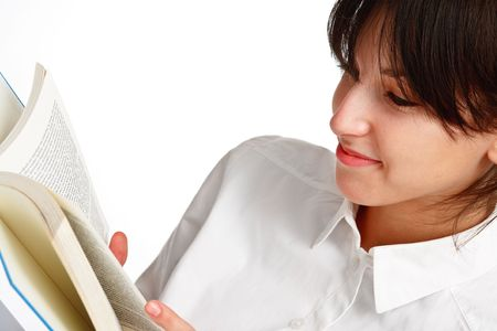 young woman reading a book and smiling, on white background Stock Photo - 6601458
