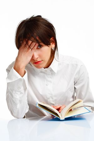 young woman with blue eyes reading a book,tired and giving up, on white background Stock Photo - 6601487
