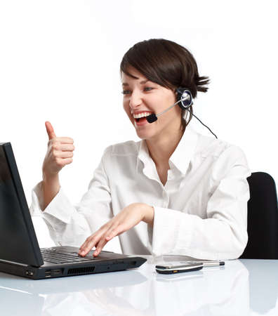 joyful woman operator with headset (microphone and headphones) showing OK and laughing Stock Photo - 6680043