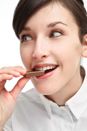 girl eating chocolate with smile and pleasure