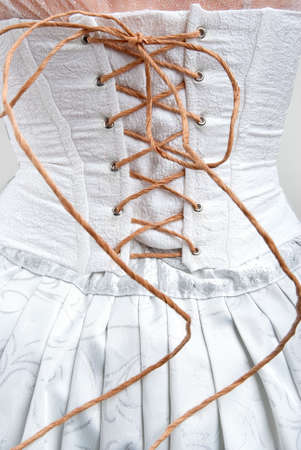 whtie corset roped with paper string Stock Photo