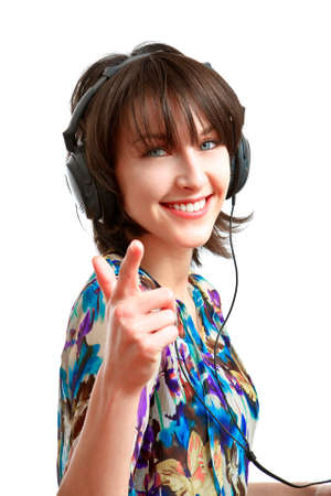 girl with headphones on smiling and pointing her finger at the viewer Stock Photo