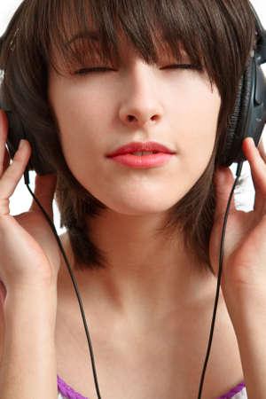 girl with headphones on - listening with pleasure