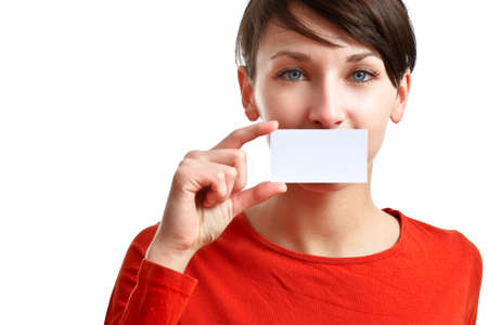beautiful girl holding an empty business card, hiding her mouth Stock Photo
