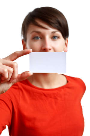 beautiful girl showing blank business card - sharpness on the card - face defocused